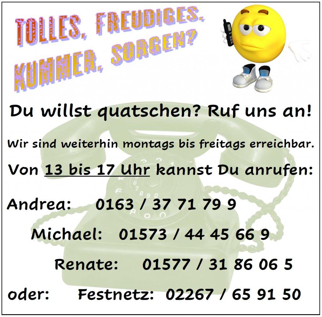 Aushang mit Telefonnummern